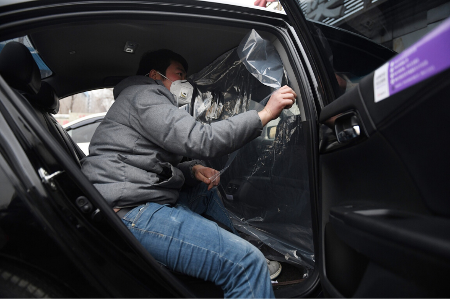 Amid Coronavirus Outbreak, Plastic Shields Protect China's Ride-Hailing Drivers