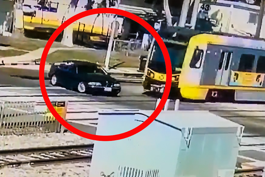 BMW Collides Head-on With Oncoming Train, Driver Walks Away Alive: Watch Viral Video
