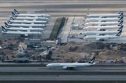 Representative image. Cathay Pacific aircraft are seen parked on the tarmac at the airport, following the outbreak of the new coronavirus, in Hong Kong, China. (Photo: Reuters)