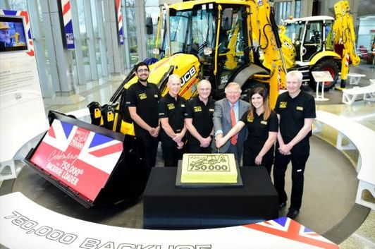 Pictured left to right are JCB backhoe loader employees Nihal Dhillon, Phil Starbuck, John Plant, JCB Chairman Lord Bamford, Shannon Ramczykowski and Keith Bloor celebrating the production of the 750,000th JCB backhoe loader at JCB World HQ, Rocester, Staffordshire  (Image: JCB)