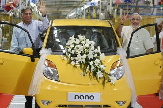 Ratan Tata and Gujarat's then chief minister Narendra Modi wave as they stand beside the Tata Nano car during the inauguration ceremony of the Sanand plant.  (File photo: Reuters)
