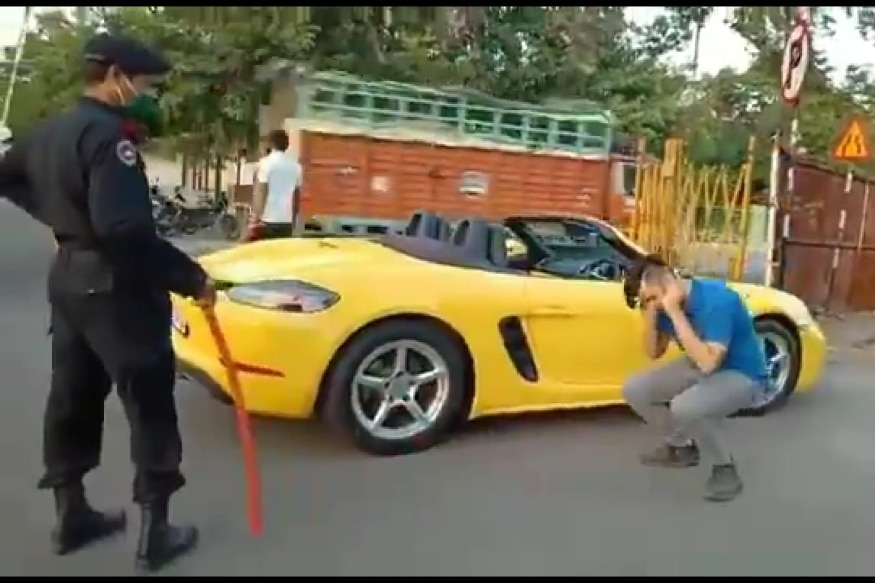Porsche driver made to do sit ups.