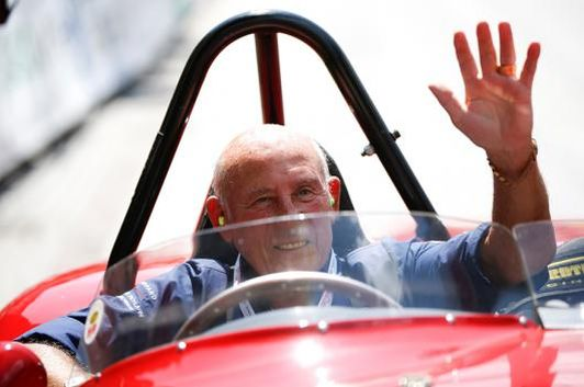 Former English Formula One driver Stirling Moss waves to spectators as he sits in his 1955 Ferrari 750 Monza during the Ennstal Classic rally near the Austrian village of Groebming July 20, 2013. (Photo: Reuters)