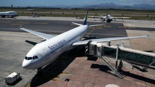 A South African Airways (SAA) aircraft is seen parked on the tarmac at Cape Town International Airport in Cape Town, South Africa, November 14, 2019. REUTERS/Sumaya Hisham